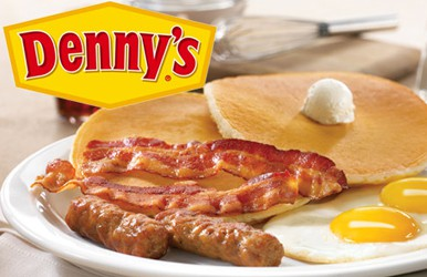 The Denny's logo over a plate of pancakes and bacon