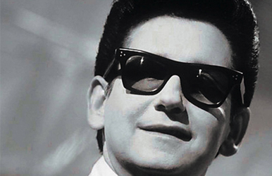 a black and white image of Roy Orbison