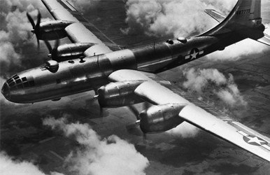 A black and white image of a WWII bomber airplane